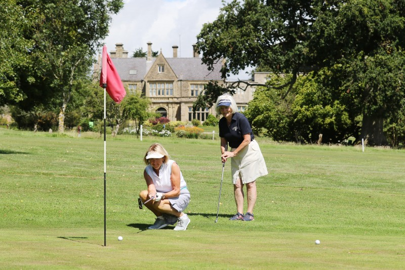 Two female golfers line up their next shot