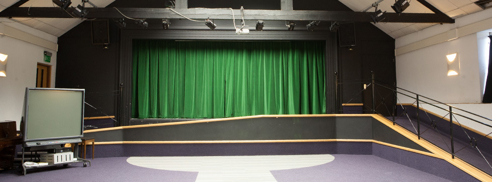 National Stars theatre with closed green curtains.