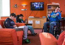 A group of National Star College students relaxing in the Lounge.