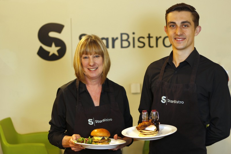 Star Bistro staff with plates of food