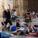 A group of student dancers perform in Plaza de la Virgen, Valencia, Spain, most of the dancers a laying on the floor