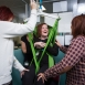 Three members of staff practice their manual handling skills using a another member of staff in a hoist