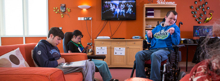 A group of National Star College students relaxing in the Lounge