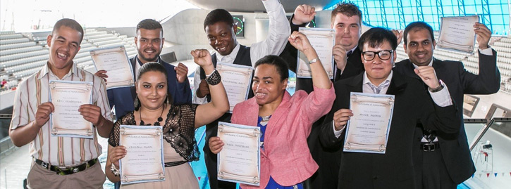 A group of National Star students hold certificates and punch the air.