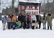 Group photograph of participants of the Leonardo Partnership Project, standing outside in the snow