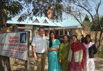 Director of International Development, David Finch stands with staff outside Shishu Sarothi Centre in India