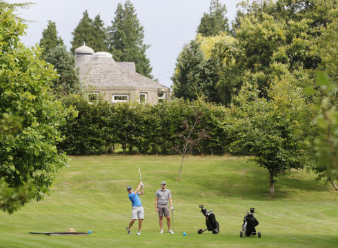 Two men on the fairway playing golf