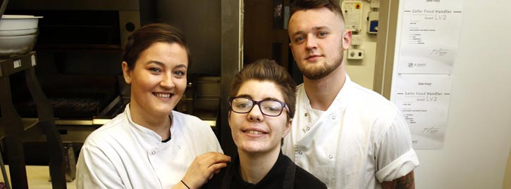 Former National Star student Chloe with her colleagues at the Spread Eagle pub