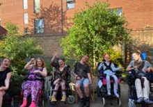 Long-term residents outside Foundation House in Gloucester celebrating their home's outstanding CQC award
