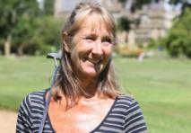 Female golfer smiling with golf club in hand
