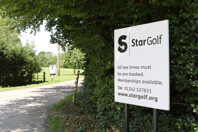 StarGolf signpost reads all tee times must be booked, memberships available