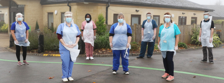National Star staff wearing PPE protective masks and clothing