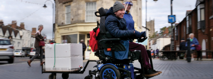Ed Scipio making meat deliveries in his wheelchair