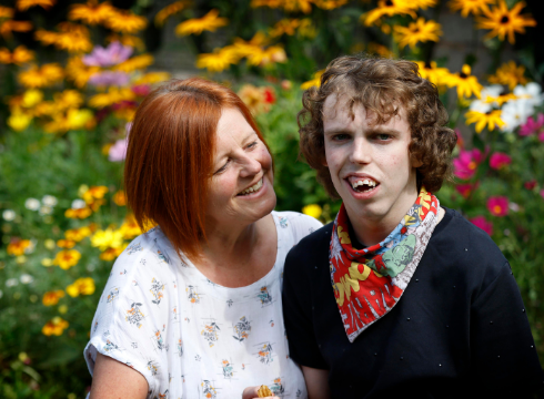 Jack and his mum Jo smiling in their garden