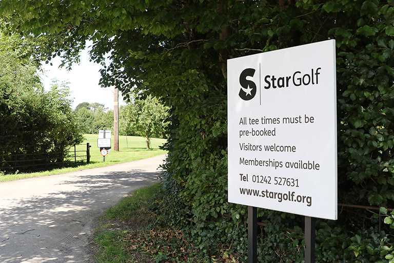 StarGolf signpost reads all tee times must be booked, visitors welcome, memberships available
