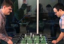 John Siglioccolo and James Johnson playing table football