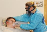 Student using breathing equipment