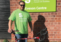 Glen holding his bike outside the Eveson Centre