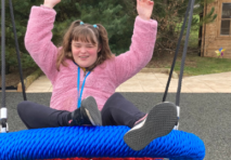 Lucy keeping fit and active on one of the new swings installed at Ullenwood