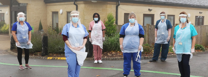 Nurses stood at the Ullenwood campus wearing PPE