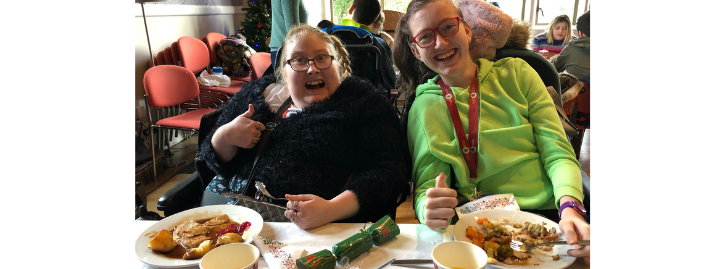 Katie and Molly smiling enjoying their Christmas dinner
