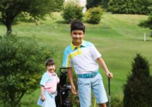 A young boy and girl on the course at StarGolf