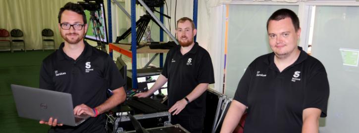 Matt Birch, Matt Overton and Joe Walker using IT equipment during the Leavers Ceremony