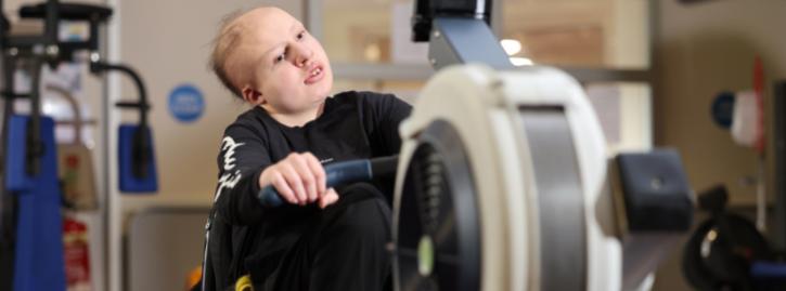 Student using gym equipment