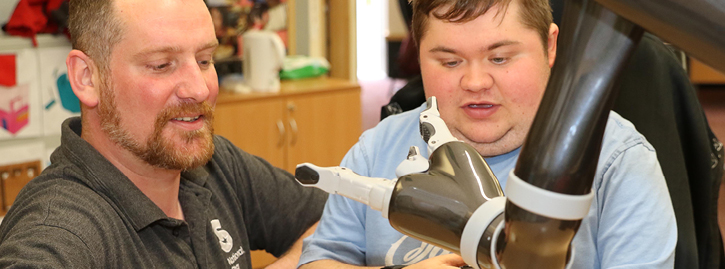 Student and teacher working with assistive equipment