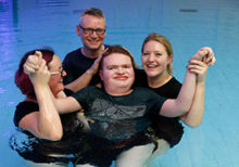 National Star Student baptised in aqua therapy pool